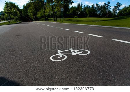 Bicycle sign path on road, bikes' lane on outskirts or urban area. Bicycle lane signage on street.