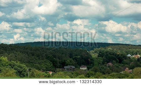 Clouds over the houses in the valley