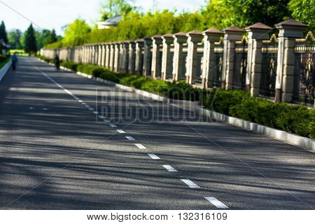 Carefree driving on a bright sunny day. Image of wide open prairie with paved highway stretching out as far as eye can see.