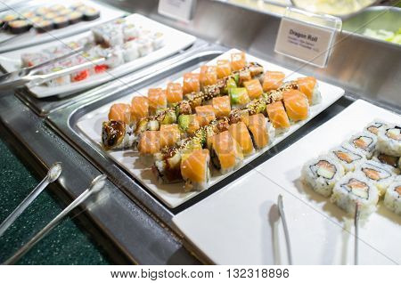 Various sushi buffet rolls at self serve station