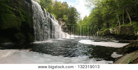Beautiful springtime waterfall with action frozen in time