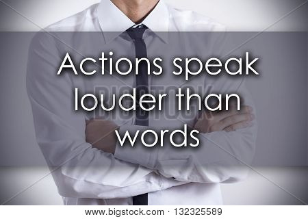 Actions Speak Louder Than Words - Young Businessman With Text - Business Concept