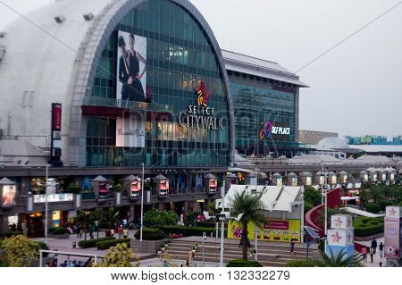 Delhi, India - 29th May 2016: Outside view of the famous Select Citywalk shopping mall in Saket, Delhi. The huge crowds testify the popularity of these shopping places