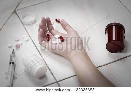 Focus on hand women after eaten pills overdose.