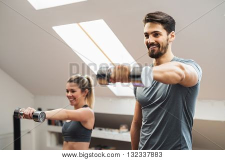 Couple doing morning fitness routine at home.