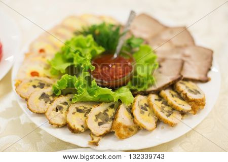 Plate Of Meat With Souce And Salad