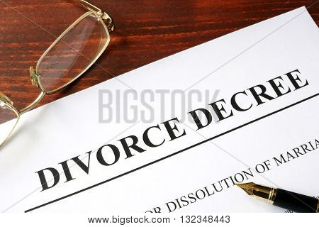 Divorce decree form on a wooden background