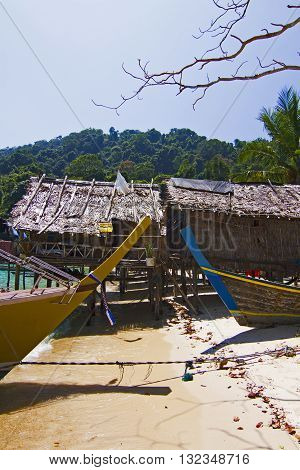 Typical houses on stilts in the Moken Sea Village on Koh Surin Tai in the Surin Islands National Park Phang Nga Thailand.