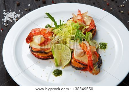 Healthy restaurant food. Ratatoille with cheese and shrimp. Seafood vegetarian vegetable carpaccio. Healthy, right eating food, restaurant french cuisine. Dish at white plate closeup