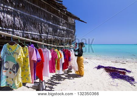PHANG NGA THAILAND - MARCH 11: Female Moken Beach Gypsies washing on Koh Surin Tai in the Surin National Marine Park Phang Nga Thailand on the 1th March 2014.