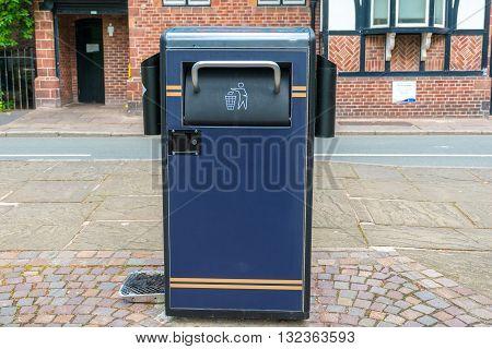 Blue Public waste rubbish bin on the street