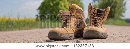 Hiking boots on a dusty dirt road