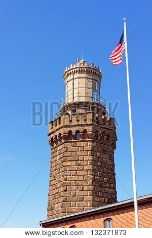 Light Station And Flag At Sandy Hook In New Jersey