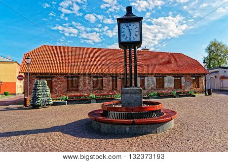 Clock In The City Hall Square Of Ventspils
