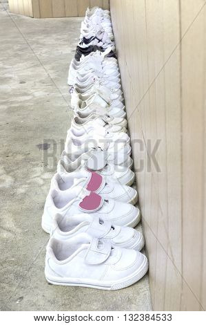 Arranged in an orderly school students shoes before entering the classroom in Thailand