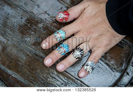 Indian Chief shaped silvers on the fingers