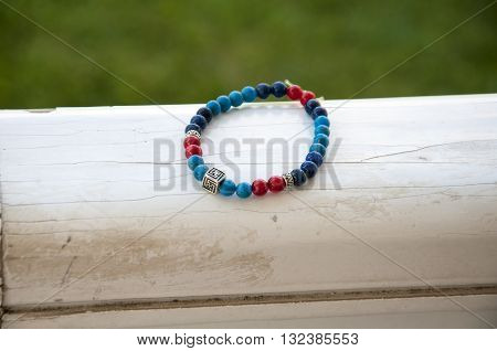multi color bead bracelet on the wood