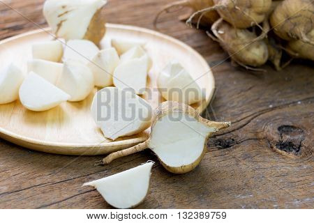 fresh cut asian jicama on wooden board