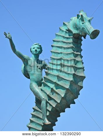 PUERTO VALLARTA MEXICO MAY 07 2016:  The Boy on the Seahorse by Rafael Zamarripa sculpture stands under along the Malecon boardwalk
