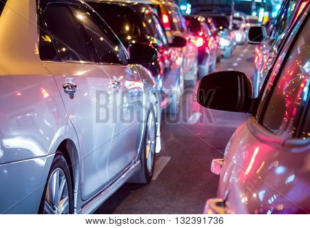 Car queue in the bad traffic road at night selective focus and processed in variant color