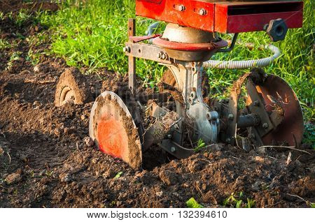 Rototiller , detail in fresh tilled soil