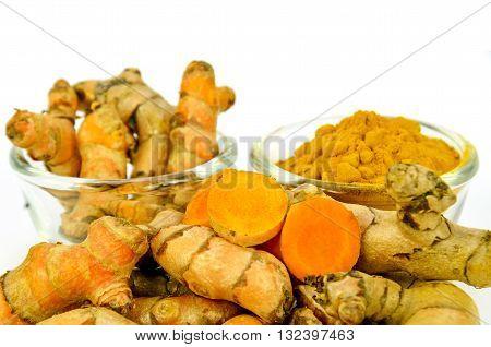 Turmeric (Curcuma longa L.) root and turmeric powder on white background.