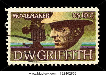 USA - CIRCA 1975: a stamp printed in the USA, shows David Wark Griffith (1875-1948), Motion Picture Producer, circa 1975;