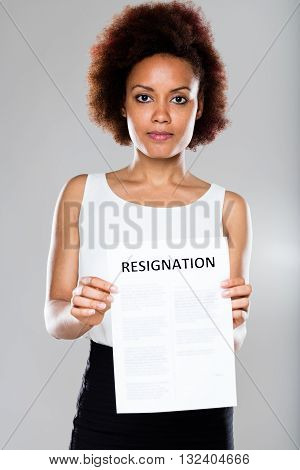 serious business woman showing a resignation contract
