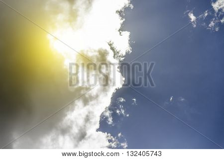 White big clouds on background of blue sky