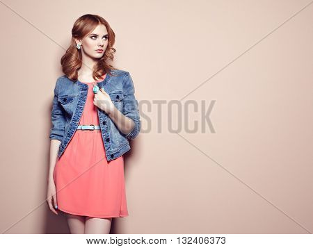Fashion Portrait Of Beautiful Young Woman In A Summer Dress
