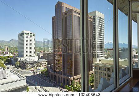 Salt Lake city Utah downtown view through a window.
