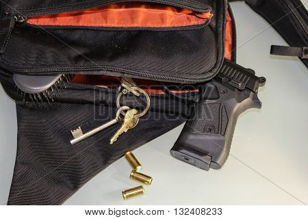 Carried concealed. Handgun and accessories falling from a woman's purse.