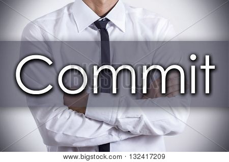 Commit - Young Businessman With Text - Business Concept