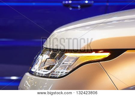 Cars body detail by night. Vehicle lights. Horizontal format