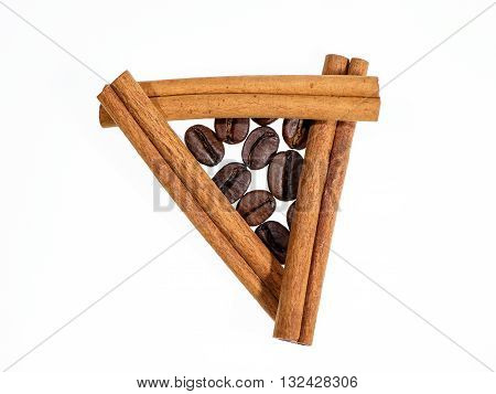 Coffee Beans In Triangle Of Cinnamon Sticks