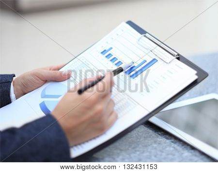 Stock market graphs monitoring. Business person analyzing financial statistics