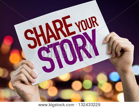 Share Your Story placard with night lights on background