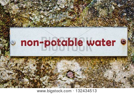 label for non potable water on old wall
