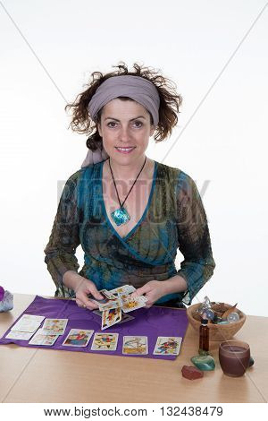 Fortuneteller Laying Tarot Cards Isolated On White