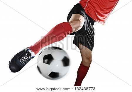 football player in action kicking ball isolated on white background wearing red jersey and sock