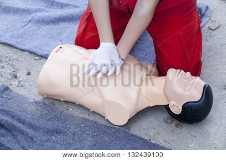 First aid training detail. Cardiopulmonary resuscitation (CPR). Chest compression.
