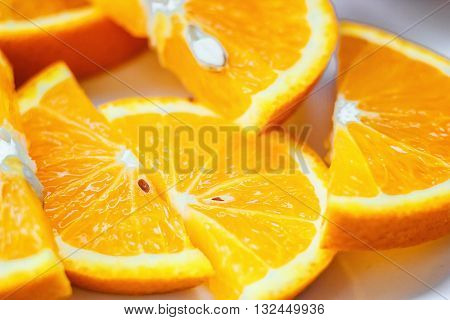 Fresh juicy orange fruit slice isolated. Citrus fruit-natural vitamin C. Studio photography.