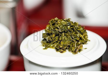 Green tea leaves after use through tea making.