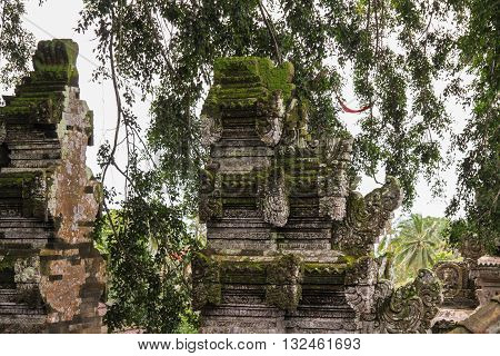 Close up of moss covered stonework in Balinese Hindu temple