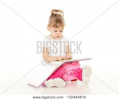 Pretty little girl  with a book sits on a pink baby potty on a white background.