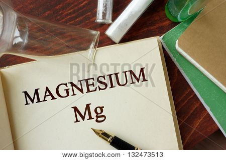 Magnesium written on a page. Chemistry concept.
