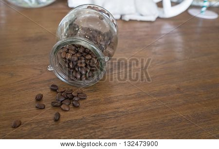 coffee bean on coffee table in coffee glass jar in coffee shop