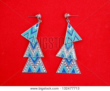 Picture of a Blue Opal Fashion Drop Earrings on Red background