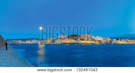 Panoramic view of Venetian quay of Chania at moonlit night, Crete, Greece