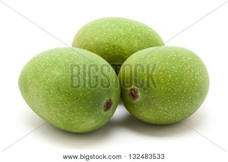 Three Organic green Indian Mangoes (Mangifera indica) isolated on white background. Front view.